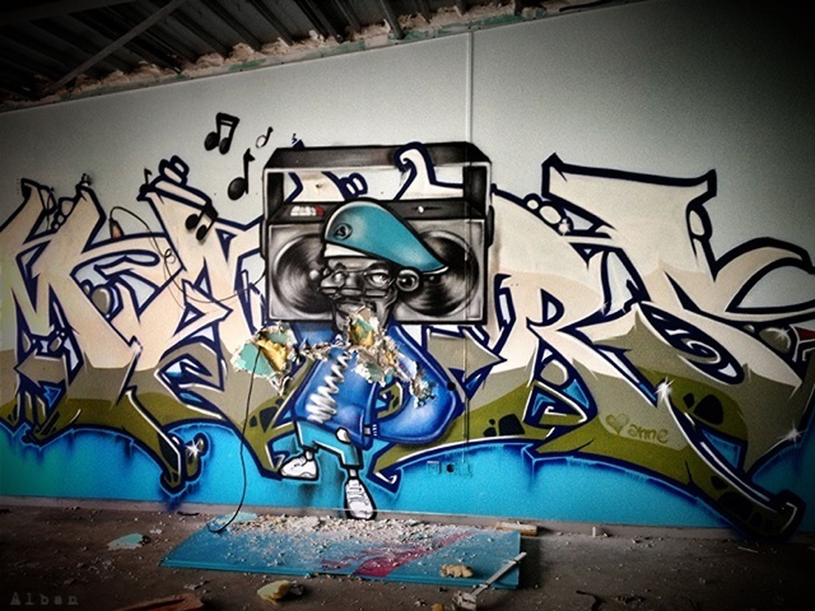 graffiti, art, creativity, art and craft, wall - building feature, built structure, architecture, street art, building exterior, human representation, multi colored, wall, text, no people, outdoors, day, mural, design, sunlight
