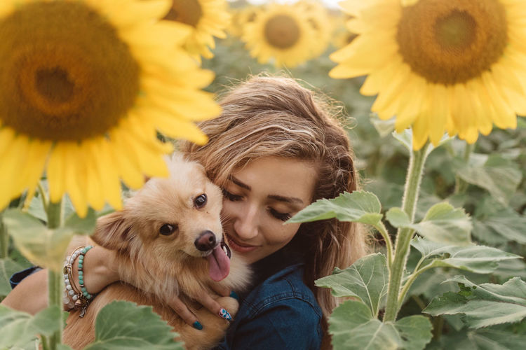 Close-up of girl with sunflower