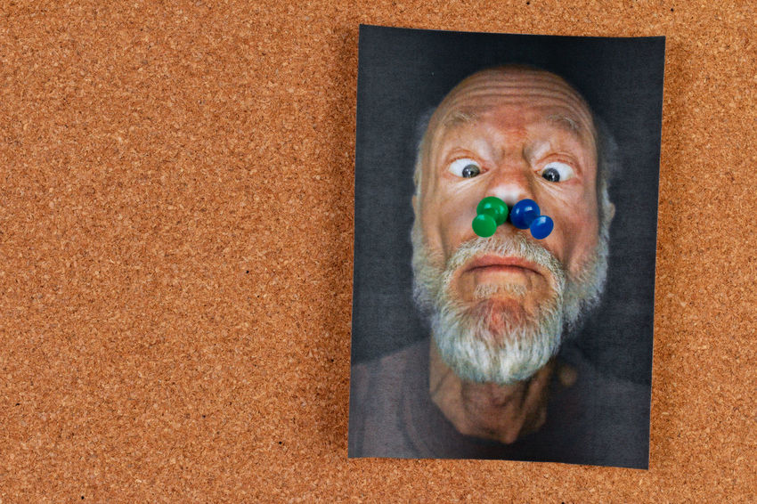 humorous picture on bulletin board with push pins Bulletin Board Humor Pins Adult Beard Body Part Close-up Cork Board Cork Material Directly Above Eye Facial Hair Headshot Human Body Part Human Face Looking At Camera Message Board One Person Photocopy Portrait Push Pins Senior Adult Senior Men The Portraitist - 2018 EyeEm Awards