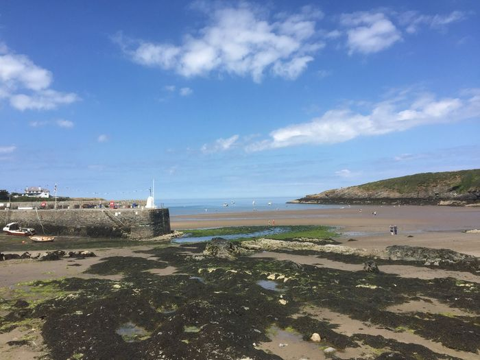 Cemaes Bay, Anglesey, UK Rock Formation Blue Sky United Kingdom Anglesey Cemaes Bay Water Sky Sea Beach Cloud - Sky Land Beauty In Nature Nature Scenics - Nature Incidental People Horizon Over Water Day Sand Outdoors Sunlight Tranquility Tranquil Scene Horizon