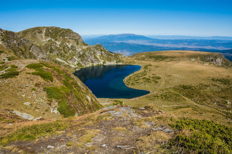 Seven Rila Lakes, Bulgaria The Kidney Бъбрека (Babreka) 2,282 m (7,487 ft) 8.5 ha (21 acres) 28.0 m (91.9 ft) Steepest shores of all Scenics - Nature Tranquil Scene Beauty In Nature Tranquility Sky Water Non-urban Scene No People Nature Environment Mountain Day Landscape Rock Blue Idyllic Remote Land Outdoors Lake Nature Nature_collection Nature Photography Beauty In Nature Lake View