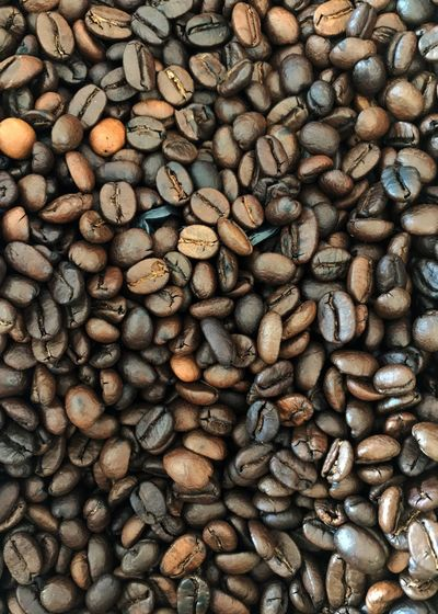Roasted coffee beans. Roasted Coffee Bean Coffee Bean Coffee Nectar Of The Gods Abundance Coffee - Drink Large Group Of Objects Vertical Roasted Brown Full Frame Backgrounds Group Of Objects Food Scented Close-up Food Stories