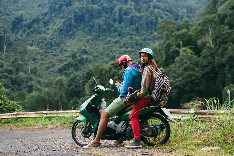 couple travel on motorcycle together in Asia. Hipster couple skaters in Vietnam jungle forest. ASIA EyeEm Best Shots Fun Longboard Motorcycle Skateboarding Travel Traveling Vietnam Active Adventure Bicycle Day Daylight Hipstamatic Hipster Jungle Lifestyles Longboarding Mountain Outdoors Skating Summer Sunset Togetherness