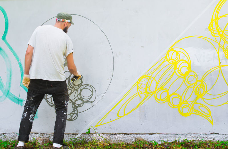 Abstract Art Adult Art, Drawing, Creativity Casual Clothing Colors Day Fantasy Graffiti Graffiti Art Guy Hands At Work Horizontal Man Modern Art Mural Mural Art One Person Outside Pattern People Sity Life Street Photography Streetart Wall Art Youth Of Today