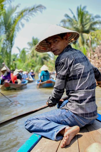 Arroyos in Mekong delta Boat Close-up Vietnam Mytho Light And Shadow Portrait Tourist Attraction