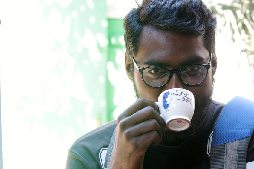 Drinking Looking At Camera Man Focus On Foreground Cup Tea Coffee Adult Headshot One Person Front View People Holding Young Adult Eyeglasses  Standing Close-up Day Outdoors EyeEmNewHere EyeEm Ready