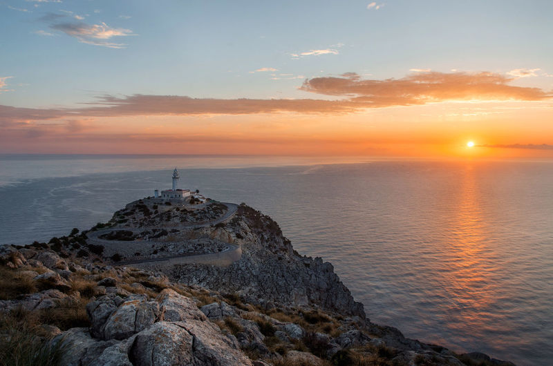 Lighthouse And Seascape During Sunset