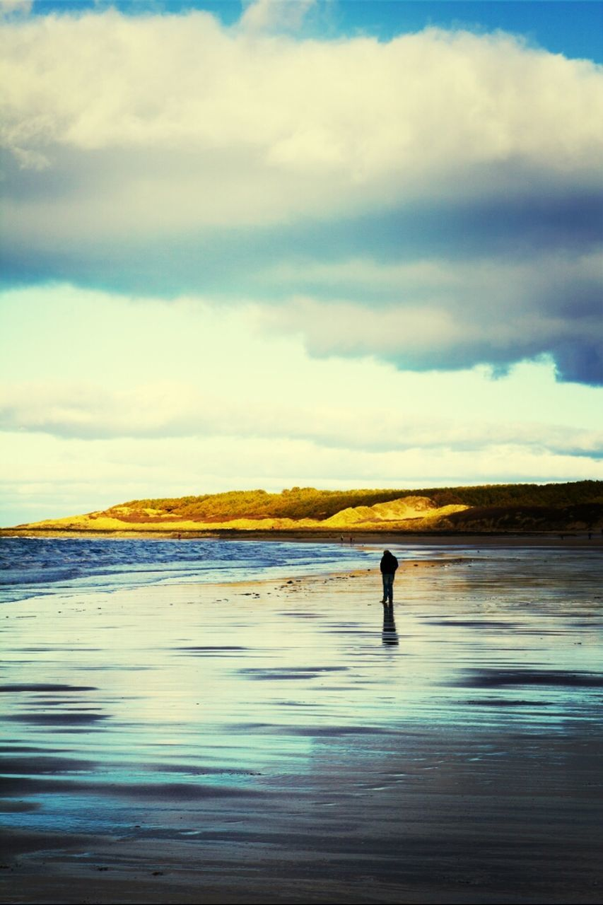 water, cloud - sky, sky, nature, sea, scenics, one person, beauty in nature, real people, tranquility, tranquil scene, leisure activity, outdoors, waterfront, silhouette, beach, men, day, standing, lifestyles, vacations, horizon over water, one man only, wave, people