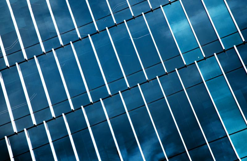 Modern exterior with mirror reflex blue sky in architecture background