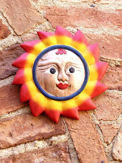 Sun 2 Italy🇮🇹 Anthropomorphic Face Sun Humor No People Multi Colored Outdoors Close-up Decoration On Wall Detail Fine Art Photography Built Structure Montepulciano D' Abruzzo Way To Live City's Of The World Brick Wall