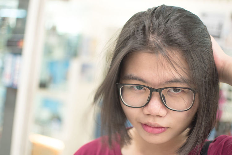 Eyeglasses  Glasses Headshot Portrait One Person Front View Focus On Foreground Close-up Women Looking At Camera Hair Young Adult Lifestyles Young Women Real People Hairstyle Females Day Teenager Beautiful Woman Contemplation