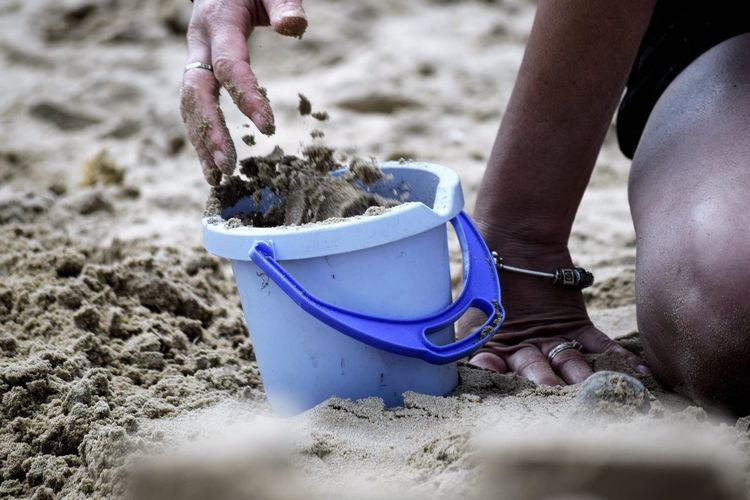 At The Beach Beach Beach Photography Blue Bucket Lady Making Sand Castles Motion Sand Sand Castle Sand Castle Making Sunny Day