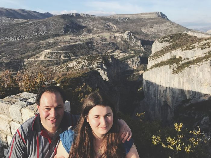 Portrait Of Couple Against Rocky Mountains