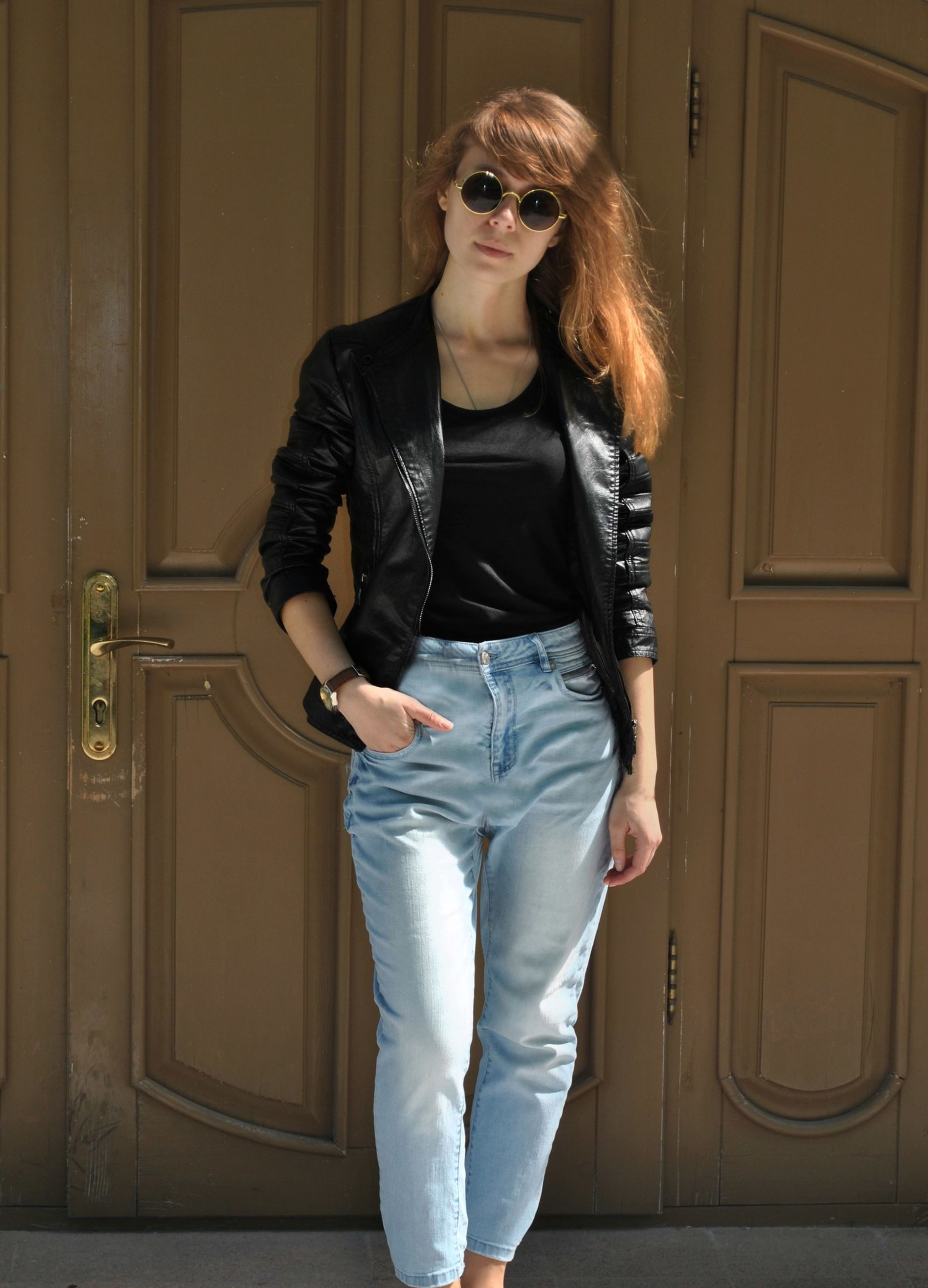 fashion, one person, young adult, standing, front view, real people, sunglasses, beautiful woman, entrance, glasses, beauty, door, lifestyles, casual clothing, young women, portrait, leisure activity, full length, hairstyle, hair, leather