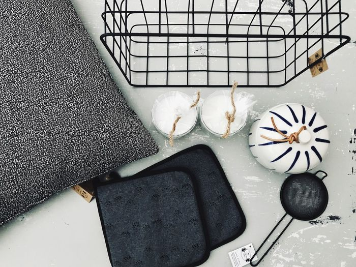 Directly above shot of kitchen utensils and tea strainer on table