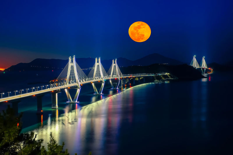 Busan - Geoje Fixed Link with blood full moon at night time, South Korea. Architecture Beautiful Construction EyeEm Best Shots EyeEmNewHere Famous Full Moon Light Reflection Skyline South Korea Under Blood Bridge Building Busan Colorful Connection Dusk Fixed Geoga Landmark Link Tunnel Water