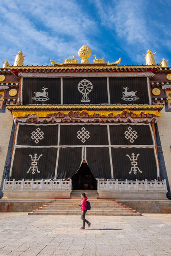 Architecture Sky One Person Cloud - Sky Building Exterior Day Full Length Built Structure Travel Destinations Nature Outdoors Entrance Adult Building Text Women Travel Ornate Temple Shangrila Shangri-La Yunnan China Tibet Religion Mountain
