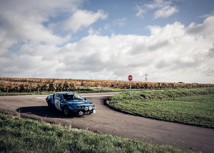 Blue Car Cloud - Sky Collection Car Day Field Grass Land Vehicle Landscape Nature No People Old Car Outdoors Road Sky Transportation