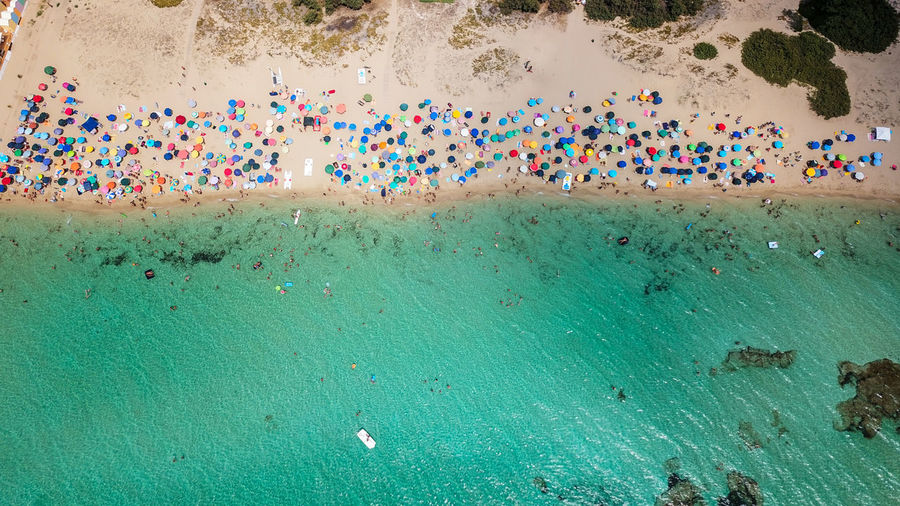 Aerial view of multi colored umbrellas on beach