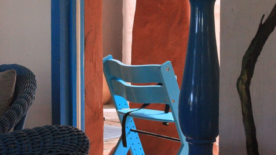Blue chair at doorway