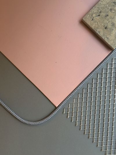 Close-up of cardboard sheet with cable and mesh