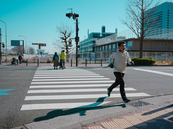 City Architecture Road Street Building Exterior Transportation City Life One Person Men Sign Full Length Built Structure Nature Road Marking Day Walking Real People Incidental People Crossing The Street Photographer - 2019 EyeEm Awards