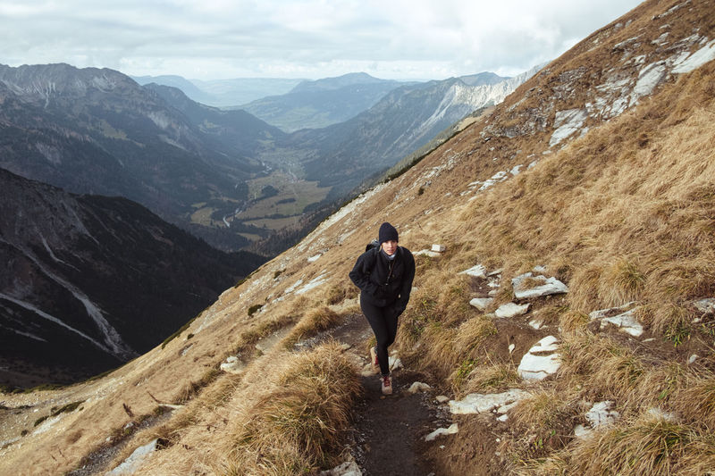 Full length of woman walking on mountain ridge