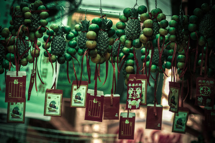 Close-Up Of Fruits With Envelope Hanging At Market