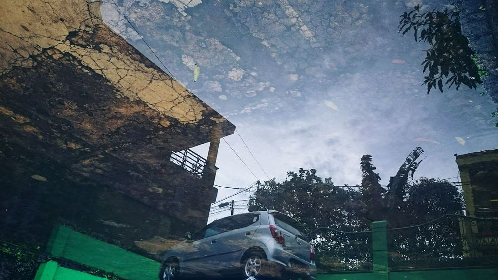 Car reflection Outdoors Car Ayla  Toyota Reflections In The Water Rain AfterRaining Sky Nature No People Tree Afternoon