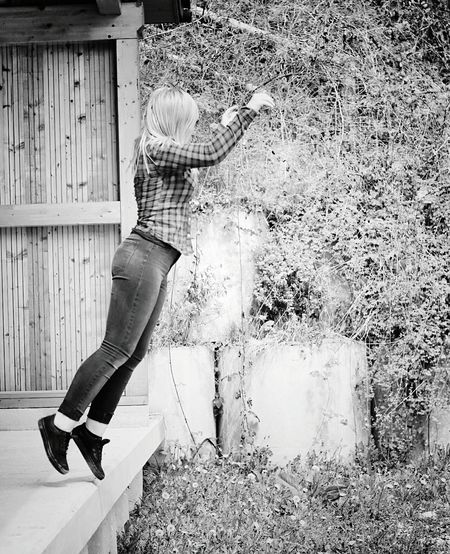 Woman jumping against the wall