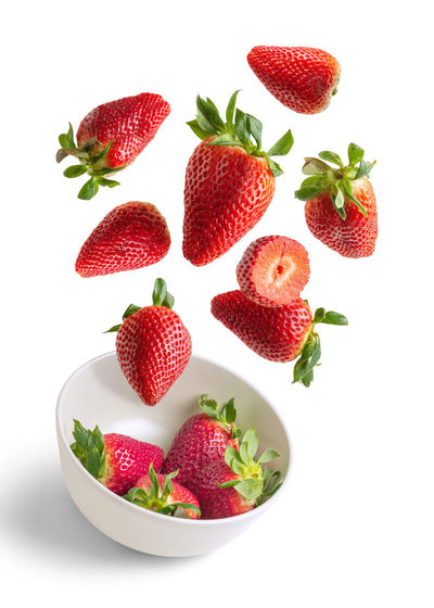 Close-up of strawberries in bowl against white background