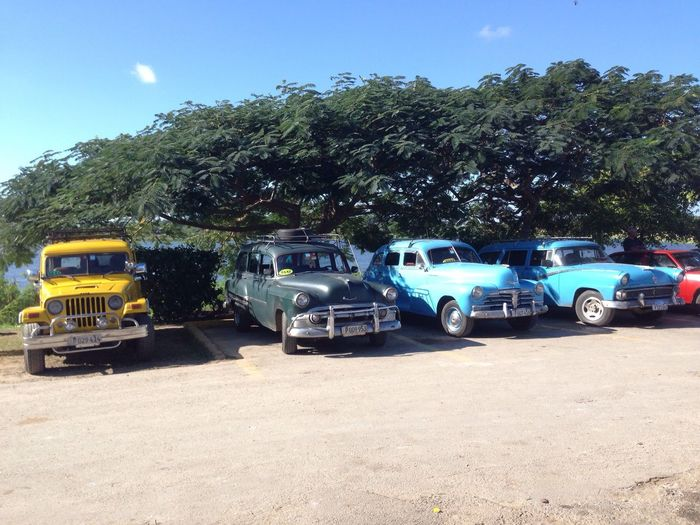 Cars parked against blue sky