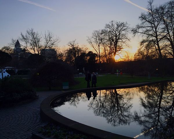 A rare Sunset with Pond Water Reflections and a Couple in Silhouette Evening