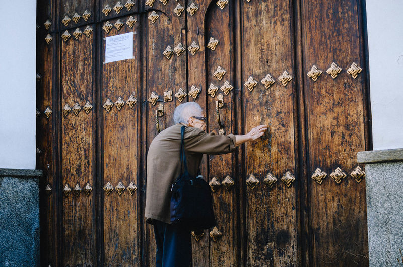 El Rezo / The Prayer Streetphotography EyeEm Selects EyeEm Best Shots Outdoors Safety Women Security Boundary Closed Clothing Waist Up Barrier Lifestyles Leisure Activity Real People Day Door Entrance Three Quarter Length Standing Adult Wood - Material One Person Church