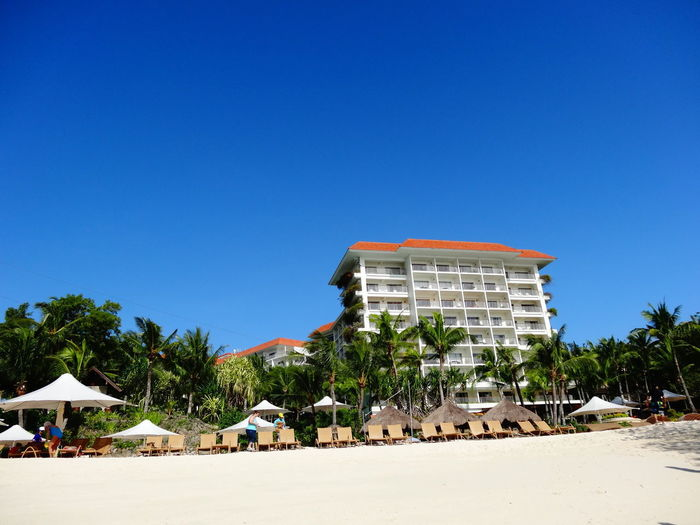 Cebu Philippines Architecture Beach Blue Building Exterior Built Structure Clear Sky Copy Space Day Nature No People Outdoors Palm Tree Residential Building Sand Sea Shangrila Sky Summer Tree Vacations