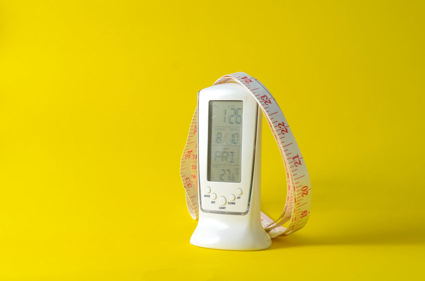 Accuracy Close-up Colored Background Communication Cut Out Indoors  Instrument Of Measurement Measuring Meter - Instrument Of Measurement No People Number Scale  Single Object Still Life Studio Shot Tape Measure Temperature Thermometer Wall - Building Feature Yellow Yellow Background