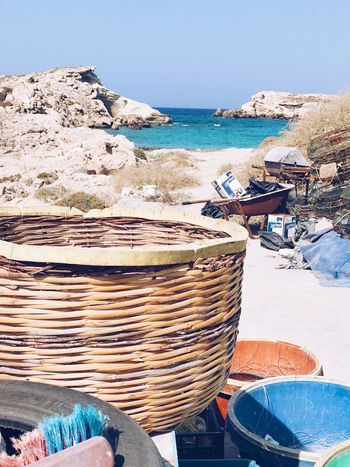 Beach Sea Day Outdoors Sand No People Nature Clear Sky Horizon Over Water Water Plastic Buckets Waterfront Rock - Object Backyard Garden Tranquil Scene Full Frame Basket Scenics Containers Backyard Landscape