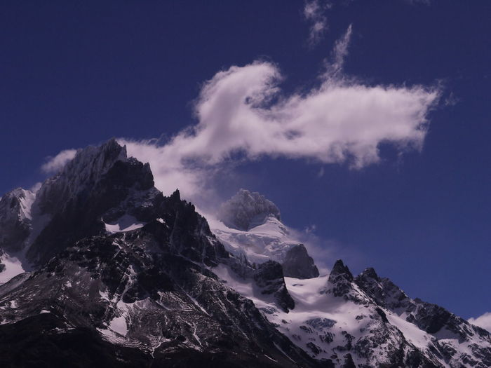 Low angle view of snowcapped mountains against sky. torres del paine mountains, chile