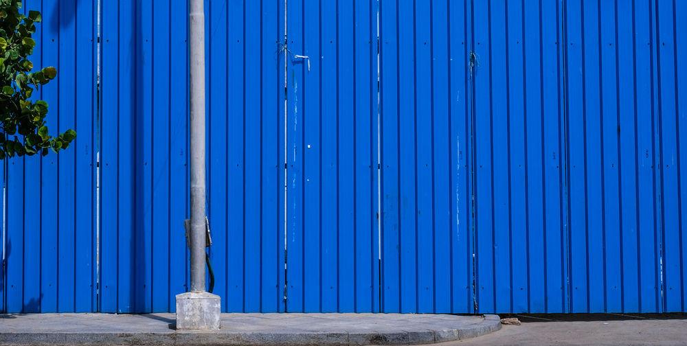Blue metal door of building