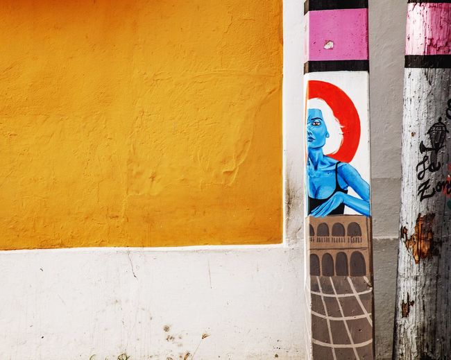 Low angle view of yellow wall