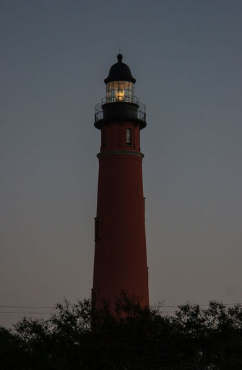 Ponce De Leon Lighthouse Ponce Inlet Architecture Building Exterior Built Structure Clear Sky Direction Early Morning Florida Guidance Lighthouse Lookout Tower Low Angle View Night No People Outdoors Ponce De Leon Protection Safety Sky Sunrise Tower Tree Warning