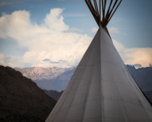Close-up of tent against mountains and sky