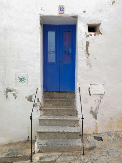 Dalt Calle San Luis. Ibiza World Heritage Site By UNESCO World Heritage Site Ibiza World Human Heritage Site World Heritage Old Town Dalt Vila Eivissa EyeEm Selects Door Blue Closed Architecture Building Exterior Built Structure