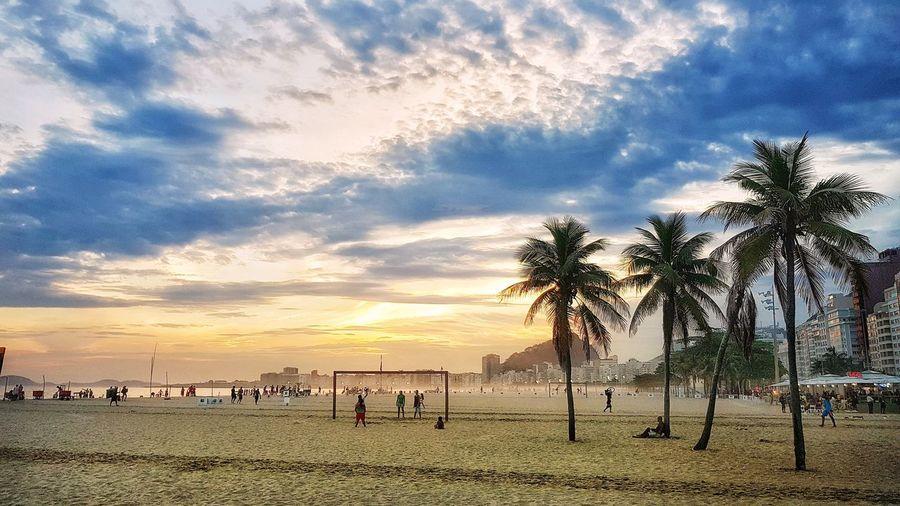 Sunset Copacabana - Rio De Janeiro Beach Sand Outdoors Beauty In Nature Palm Tree Cloud - Sky