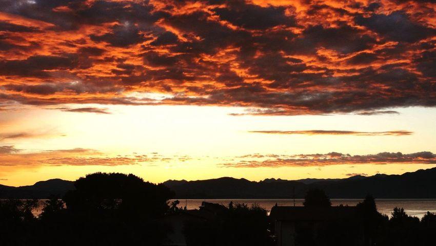 Sky on fire near Lago di Garda, Italy Horizon Like Fire Orange Fire Clouds Sunset Sunset Sky Beauty In Nature No People Nature Outdoors Scenics