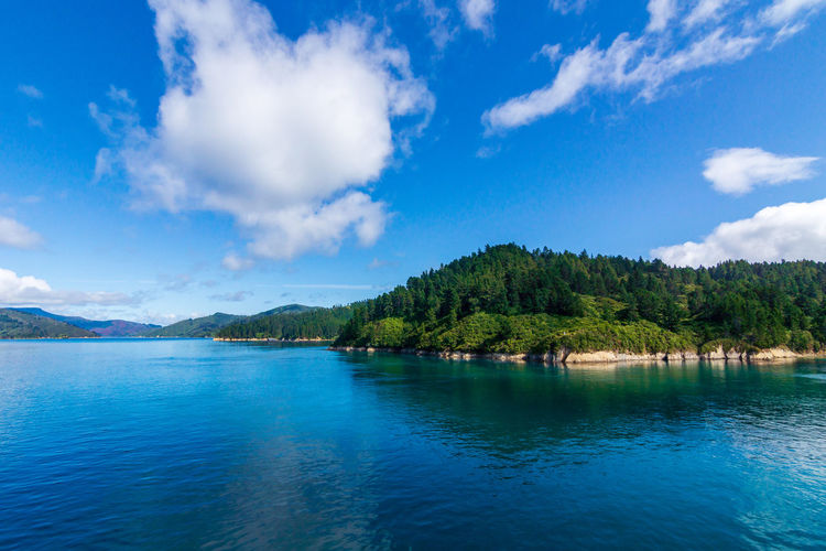 Scenic view of marlborough sounds against blue sky