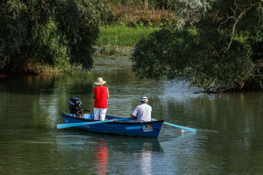 Danube Delta Danube Adult Beauty In Nature Day Family With Two Children Father Full Length Leisure Activity Mature Adult Men Nature Nautical Vessel Oar Outdoors Real People Rear View River Sitting Togetherness Transportation Tree Vacations Water Waterway To Sulina Women