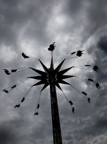 Cloud - Sky Sky Low Angle View Nature Silhouette Chain Swing Ride No People Outdoors Amusement Park Arts Culture And Entertainment Amusement Park Ride Overcast Tall - High