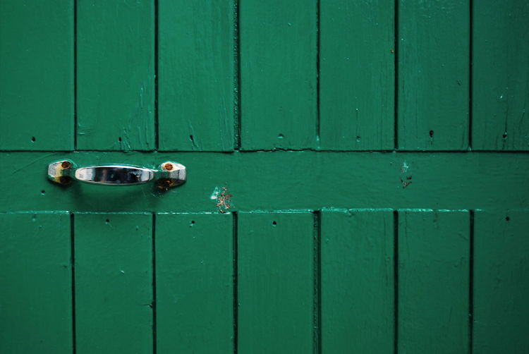 Close-up of green closed door