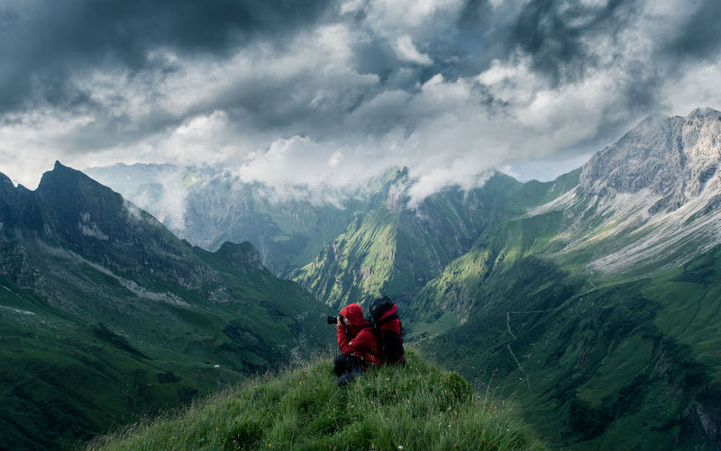 Adventure Buddies Adventure Club Dramatic Sky Hiking Red Taking Photos Adult Adventure Backpack Beauty In Nature Cloud - Sky Clouds And Sky Exploration Green Color Healthy Lifestyle Hiking Hikingadventures Mountain Mountain Range Nature Outdoors People Scenics Togetherness